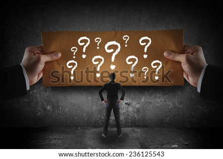 businessman looking at question mark - stock photo