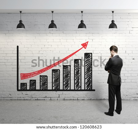 businessman looking at scheme profit - stock photo