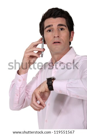 Businessman looking at the time - stock photo