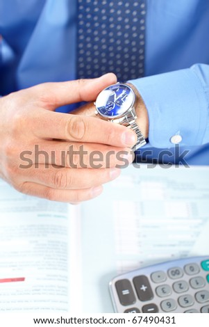 Businessman looking at the watch - stock photo