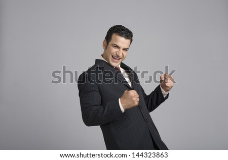 Businessman looking excited - stock photo