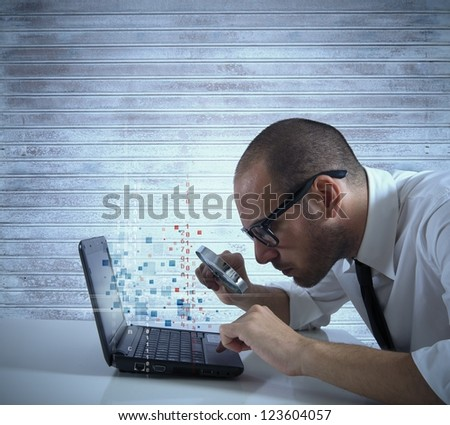 Businessman looking for virus and hacking in a laptop - stock photo