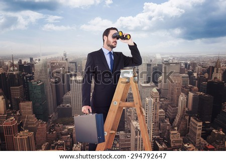 Businessman looking on a ladder against new york - stock photo