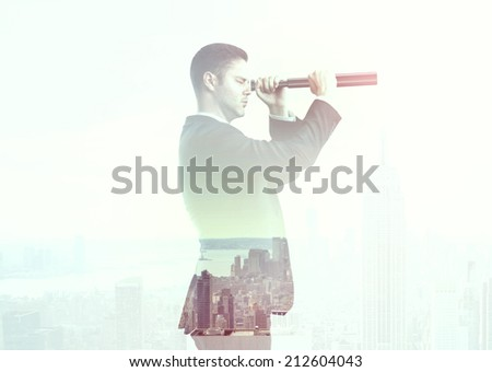 businessman looking through a telescope to city - stock photo