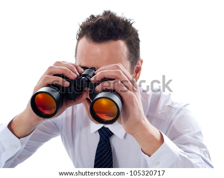 Businessman looking through binoculars isolated on white background - stock photo