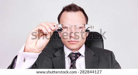 businessman looking through glasses - stock photo
