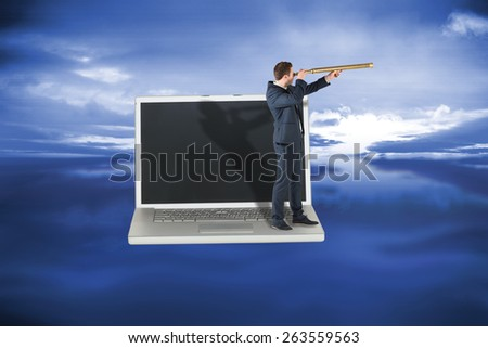 Businessman looking through telescope against blue sky with blue clouds - stock photo