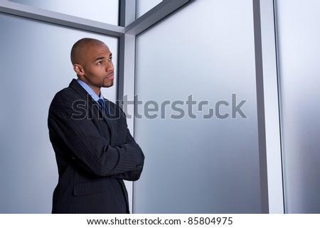 Businessman looking through the window with a worried expression. - stock photo