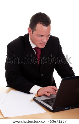 businessman looking to computer, isolated on white background. Studio shot. - stock photo
