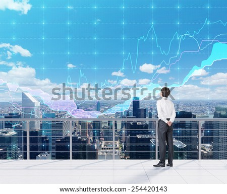 businessman looking to forex charts and view on city - stock photo