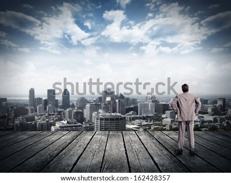 Businessman looking urban view. vision and perspective - stock photo