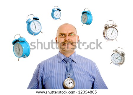 Businessman looking very stressed while various clocks are swirling around his head - stock photo
