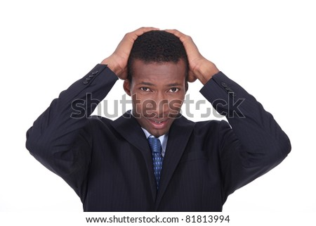 Businessman looking worried - stock photo