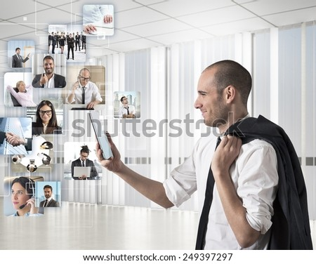 Businessman looks at his team to action - stock photo
