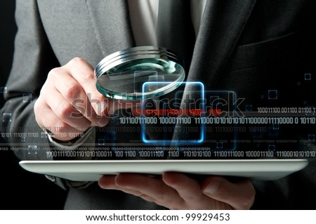 Businessman looks for the malicious code of a virus - stock photo