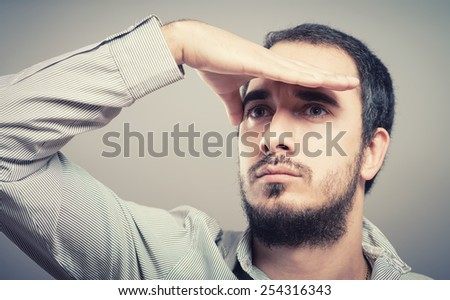 Businessman looks into the distance  - stock photo