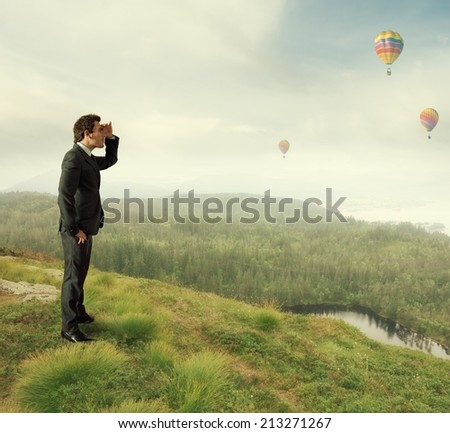 Businessman looks to the future for new job opportunities - stock photo