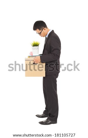 Businessman loses his job with carrying his belongings - stock photo