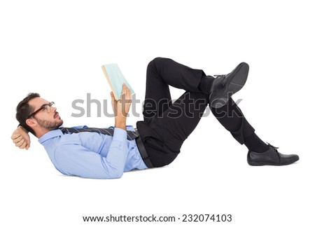 Businessman lying on the floor while reading a book on white background - stock photo