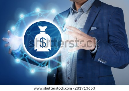 Businessman make money and save money on virtual screens. Business, technology, internet, concept. - stock photo