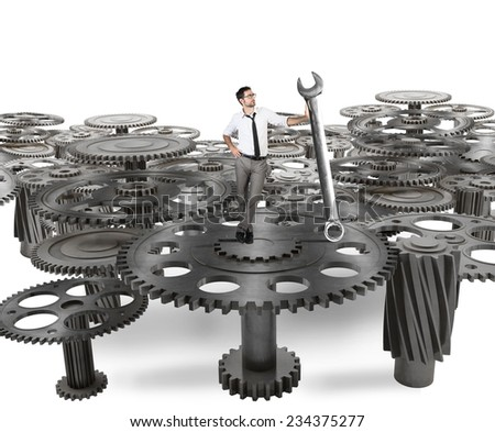 Businessman makes maintenance of a system of gears - stock photo