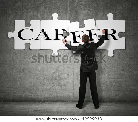 Businessman making a puzzle on the wall with the word Career - stock photo