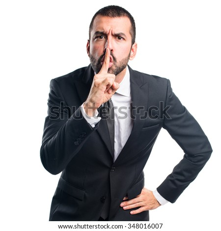 Businessman making silence gesture - stock photo