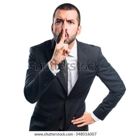 Businessman making silence gesture - stock photo