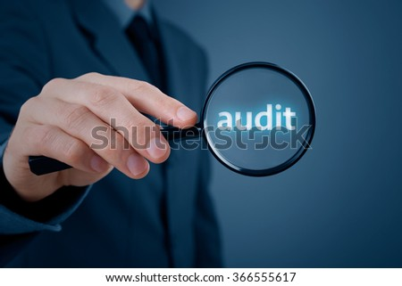Businessman manager focus on audit with magnifying glass. - stock photo