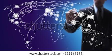 businessman marking on the largest world economies map. - stock photo