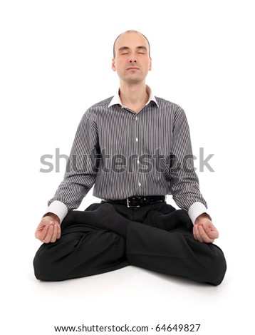 businessman meditating in yoga lotus - stock photo