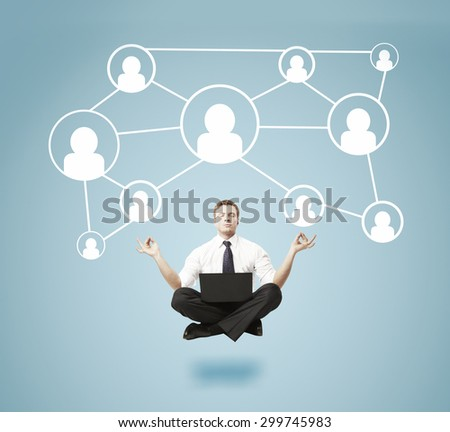 businessman meditating  with social icons - stock photo