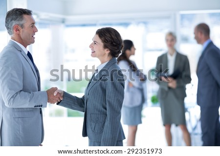 Businessman meeting her partner at the office - stock photo