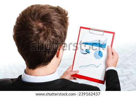 Businessman monitoring stock market graphs - stock photo