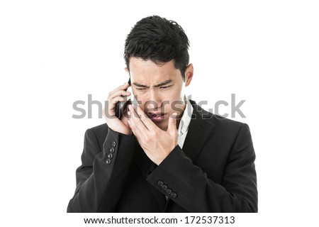 Businessman murmuring to the phone - stock photo