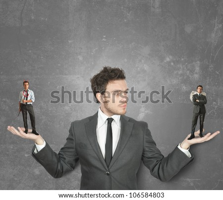 Businessman must choose between the devil or angel - stock photo