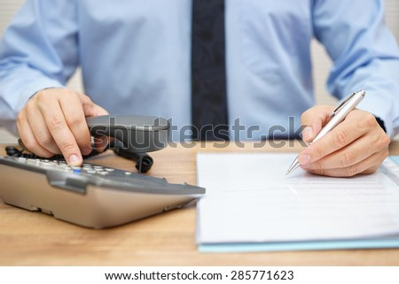 businessman needs assistance for legal document and calling his adviser - stock photo