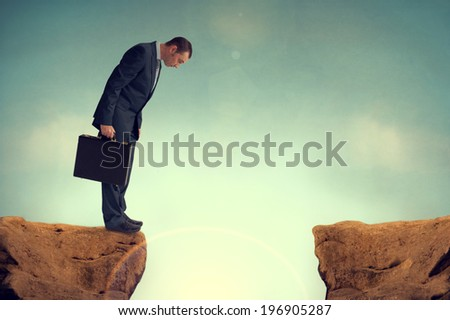 businessman nervously facing an obstacle challenge - stock photo