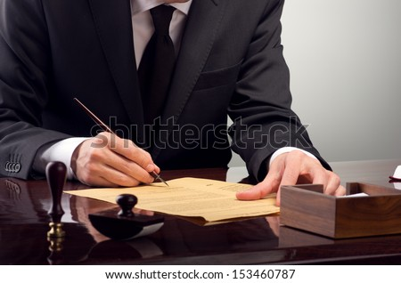 Businessman notarize testament at notary public office - stock photo