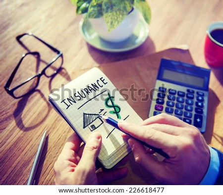 Businessman Notepad Insurance Word Concept - stock photo