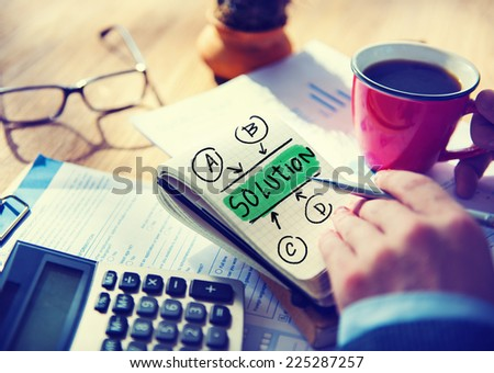 Businessman Notepad Solution Word Concept - stock photo