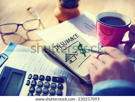 Businessman Notepad Word Insurance Concept - stock photo