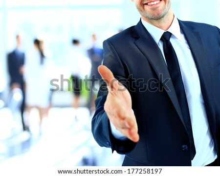 Businessman offering a handshake - stock photo