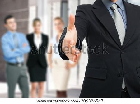 Businessman offering an handshake - stock photo