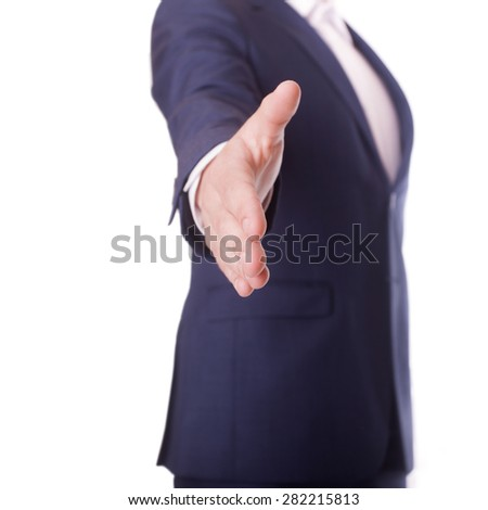 Businessman offering for handshake isolated on white - stock photo