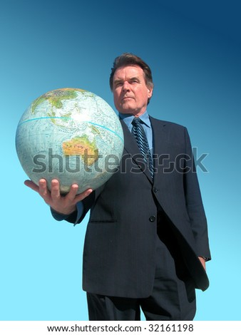 Businessman offering the world - stock photo