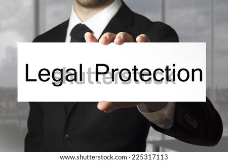 businessman office showing sign legal protection - stock photo