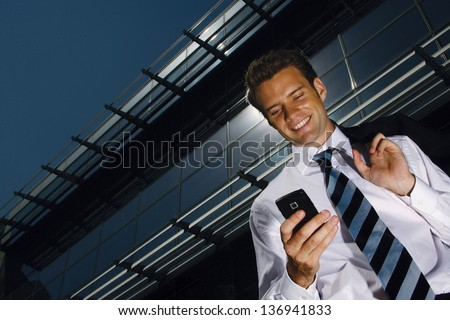 businessman on a background of a modern building - stock photo
