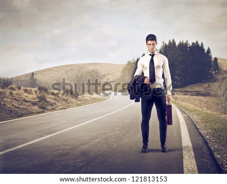 Businessman on a long road - stock photo