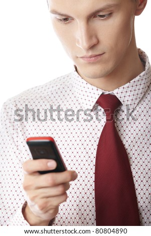 Businessman on a white background holding cellular phone and typing SMS - stock photo